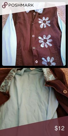 Two piece shirt set Grwat condition long sleeve blueish/green shirt with a vest.  The vest has a hand stitched design on the front.  There is a small stain on the front of the undershirt. Tops