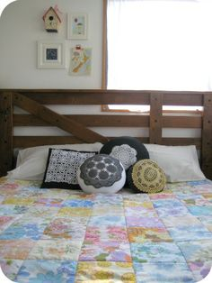 vintage sheet quilt with vintage wool blanket backing.  The dyed doily cushions are great too!!