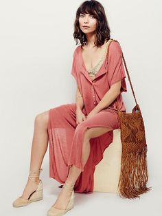 Marrakesh Dress | Semi-sheer maxi dress with button placket front and scoop neck. Long slit up each side. We love throwing this over our bikini for a day at the beach and tying the bottom together for a casual cool look.   *FP Beach   *One of 9 exclusive, in-house labels.  *Effortless seaside styles.