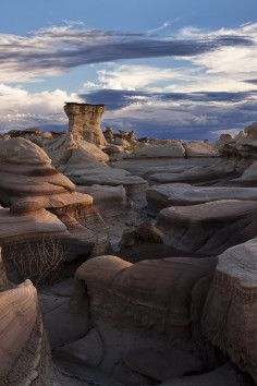 It's hot out in the Bisti badlands, 114 plus when we visited.  It's worth seeing even though you drive on endless dirt roads past signs warning you of gas explosions to get there!  A memorable experience! Bisti Wilderness in Farmington, New Mexico has unusual scenery.