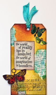 Learn to make a beautifully blended background with Tim Holtz Distress Inks and Dylusions Ink Sprays.