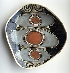 The design on this ultra large and unique platter depicts the estuary and creek at Hat Head Mountain on the mid north coast of NSW. The tide and sand have created three distinct pools. This country's traditional owners are the Ngaku people. 38cm x 34cm x 7cm
