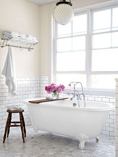 Classic Style - clawfoot tub by Sunrise Specialty; carrara marble floors; light fittings by Rejunvenation; repurposed wood plank as a rustic bath shelf