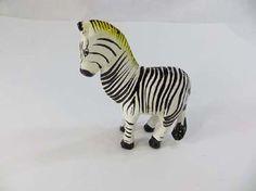 wooden zebra statue hand-carved hand-painted $4.25 - http://www.wholesalesarong.com/blog/wooden-zebra-statue-hand-carved-hand-painted-4-25/