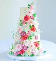Lulu's Sweet Secrets: five-tier buttercream wedding cake decorated with sugar roses, dahlias, hyacinthus, ranunculus and tulips. #weddingcake #sugarflowers