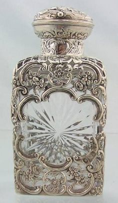 Cut glass perfume scent bottle with silver overlay, by William Comyns, London It begs for a delicate mille-fleurs fragrance, with green leaf undertones. Perfumes Vintage, Antique Perfume Bottles, Vintage Bottles, Bottles And Jars, Glass Bottles, Glass Vase, Objets Antiques, Beautiful Perfume, Bottle Art