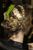 "Dolce & Gabbana-From the back, hairstyles were accessorised with coins, jewels and even leaves, in keeping with the ""ancient"" theme of the collection."