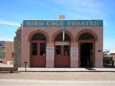 Bird Cage Theater, Tombstone, Arizona: Both staff and guests have reported seeing ghostly apparitions in 1800's clothing. Other occurrences include the sounds of raucous laughter and music at night. Others report hearing the faint sounds of a woman singing. Others have reported strange sounds coming from the balconies of the main floor and the scents of cigar smoke and whiskey. After closing time, staff have reported hearing the sounds of clinking glass and cards shuffling.