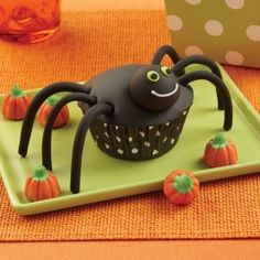 Wilton Spider Cupcakes from @officialacmoore. Add a creepy touch to your Halloween celebrations by making your cupcakes into spiders!