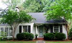 white painted brick house with grey roof - Google Search