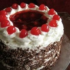 Dark chocolate cake layers are filled with cherry pie filling spiked with cherry liqueur.  If using this recipe to make a 9x13 inch cake, increase the baking time to 40 minutes.