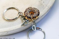 best friend keychain, BFF keychain, initial keychain, couples keychain, Donut keychain, sister keychain, Sweet keychain, Friendship keychain Chocolate with nut  Initial: Choose your initial from the drop down menu  This listing is for two donut half keychains. The size of the donut are ap. 25mm  ● More keychains: https://www.etsy.com/shop/Velwoo?section_id=17157676&ref=shopsection_leftnav_8 ● More donut items: https://www.etsy.com/shop/vel...
