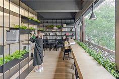 Deze moderne boekhandel in Beijing brengt het beste van drie werelden samen - Roomed | roomed.nl