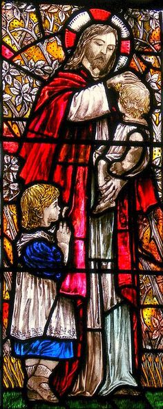 Stained Glass window in Holy Trinity parish church, Bracknell, Berkshire by Christopher Whall and dates from 1906. It shows Jesus blessing the children: in classic Whall style they are dressed in Edwardian clothes.
