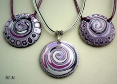 Pretty purple polymer clay round pendants using swirls and canes.