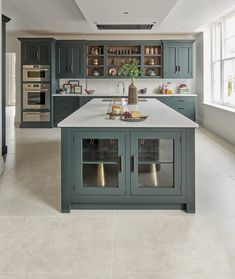 The beautiful bespoke island features integrated wine storage and a combination of open and closed storage for pots, pans and crockery. A built-in sink unit and work surfaces allow the cook to prep food while facing the family. Considering details such as these demonstrates how your kitchen is created around the way you use it.