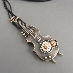 Pendant - steampunk violin. The pendant contains flash drive with a capacity of 8GB. Made from scratch with sterling silver. Additivies: