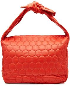 A quilted texture and bright red coloring makes this roomy tote a smart and  versatile investment from Victoria Beckham. 23adf078ce32b