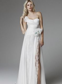 """A long slit in this wonderful 2013 Blumarine dress... with a nice flower at the top, in the right side.  The wedding day must be... """"special"""" also dressing this special dress... and, like a creative Wedding Planner, I recommend this style to every girls wish to be... 'differently sexy'."""