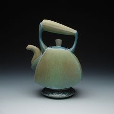 """""""Ceramic Tea Pot""""  Ceramic Teapot by Frank Saliani         This tea pot was created for a tea lover with a fondness for unique objects. Cast from colored slip in hand-made molds, this functional tea pot stands approximately 10"""" high, and has a built-in ceramic screen for loose leaf teas. The pot holds approximately 2.5 eight-ounce cups of tea, pours beautifully, and feels great in the hand."""