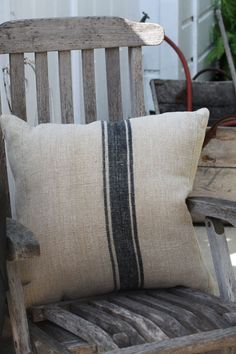 Teak deck chairs with French linen pillows for my stone patio.