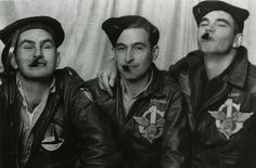 Glider pilots Sam Altman, Frank Randall, and Troy Shaw of the 1st Air Command Group goof around for a photographer in India in 1944.