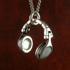 "Music Jewelry Antique Silver Music Necklace Headphones Pendant on 24"" Antique Silver Chain. $60.00, via Etsy."