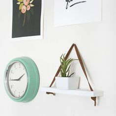 Create this easy hanging shelf with a little bit of leather and some scrap wood!