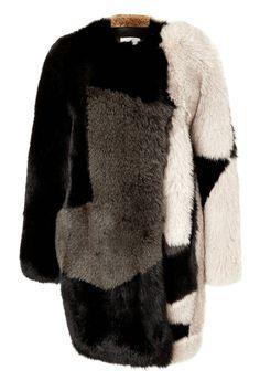 Preen Fox Fur Coat - Shop more holiday chic furs at ShopBAZAAR.com http://www.harpersbazaar.com/fashion/real-fur-jackets-and-vests