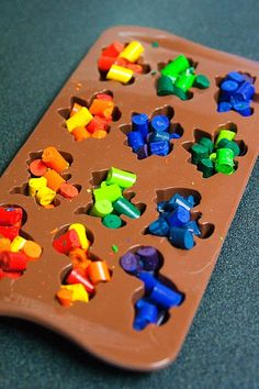 Dinosaur crayons  Place broken crayons in silicone muffin pan and bake at 200 degrees for about 20 minutes. Put the tray with melted crayons in the freezer or let it cool on the counter and that's it! Source: Treasures for tots