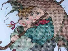 """Hummel's Umbrella Children """"Stormy Weather"""" / """"In The Rain""""  cross stitch pattern, completed (enlarged section)"""