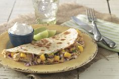 These Mango Chicken Quesadillas are sweet AND savory. Don't take our word for it - try for yourself!