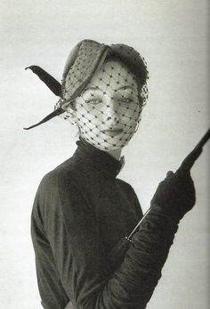 hat. Model wearing an ensemble by Jacques Fath, 1951. Photo by Willy Maywald.