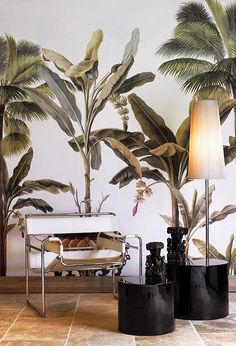 Cool wallpaper with tropical plants and Bauhaus chairs on the floor.