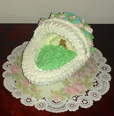 """Baby's First Easter"" Sugar Egg Bassinet with Baby Bunny Asleep Nestled in ""Cabbage Leaves"".  Featuring Basket Weave, Ruffles, and Rose Buds."