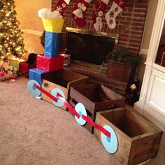Choo choo train for Clay's party out of wooden boxes. For pictures with the kids and presents to be placed!
