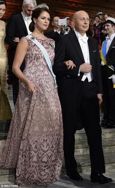 Nobel chemistry laureate Stefan W. Hell arrives with Sweden's Princess Madeleine for the Nobel banquet