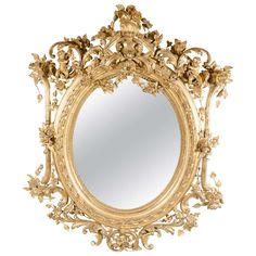 French Rococo Oval Mirror with 24-Karat Gold Gilt and Foliage Details | From a unique collection of antique and modern mantel mirrors and fireplace mirrors at https://www.1stdibs.com/furniture/mirrors/mantel-mirrors-fireplace-mirrors/
