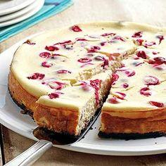Cranberry Orange Cheesecake: Chocolate, cranberry, and orange combine in this irresistible cheesecake recipe. /