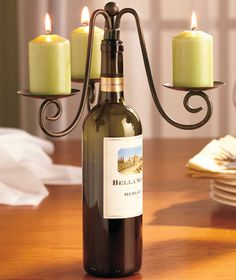 Wine bottle candelabra from the Lakeside Collection ($7.95/each)... would be absolutely great for the centerpieces. @Quinn Perry