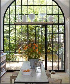 Gorgeous steel windows/doors.  Not so sure about that shelf above the door.