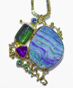 Boulder opal jewelry designed and made by Jennifer Kalled as well as work from over two hundred small studio American artists. Gifts, and custom made jewelry