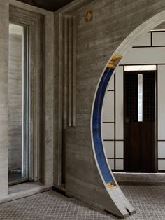Carlos Scarpa -concrete with brass and coloured relief details.