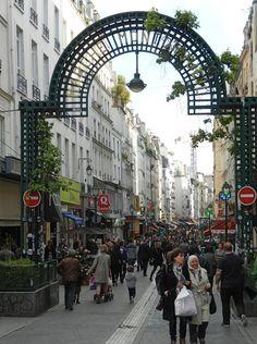 entrance to the rue montorgueil street market, 2nd arrondissement, paris, france   shopping + travel