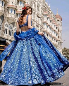 In love with this blue lehenga in foil, resham and mirror work by Mumbai based designer . Price for this one is… Indian Fashion Dresses, Indian Bridal Outfits, Dress Indian Style, Indian Designer Outfits, Blue Lehenga, Bridal Lehenga Choli, Indian Lehenga, Designer Bridal Lehenga, Lehnga Dress