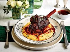Braised Lamb Shanks with Parmesan-Chive Grits Recipe | You'd never guess that this sophisticated dish was made in a slow-cooker. The key to restaurant-quality lamb results is to select shanks roughly the same size and that have been trimmed of excess fat and the tendons along the bone. Save the reserved liquid for making incredible grits.