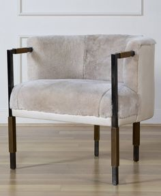 KELLY WEARSTLER | LARCHMONT CHAIR. Two tone upholstery and burnished brass legs