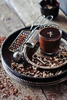 Hot Chocolate ~ 400 g - dark chocolate (70%)  1 cup milk (240 ml)  2 tbsp - butter  Pinch of cinnamon (optional)  Ground black pepper (optional and to taste)  Pinch of dried ginger Preparation:  Chocolate (break into pieces) and melt the butter in a saucepan with a thick bottom over low heat, add milk, stirring constantly, bring to a uniform consistency. Add pepper, cinnamon, ginger.  Hot chocolate to warm up in the rainy, autumn days!