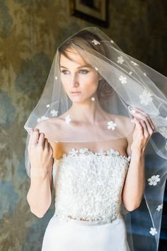 Smattering of scattered daisies make this veil a darling addition on your wedding day.
