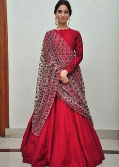 Tamannaah Bhatia at 'Speedunnodu' Audio Launch : Tamannaah looked pretty in a red A-line Mayyur Girotra lehenga with Suhani Pittie earrings. Her hair and makeup was fine. Indian Fashion Dresses, Indian Gowns Dresses, Dress Indian Style, Indian Designer Outfits, Indian Outfits, Ethnic Fashion, Party Wear Indian Dresses, Women's Fashion, Salwar Designs